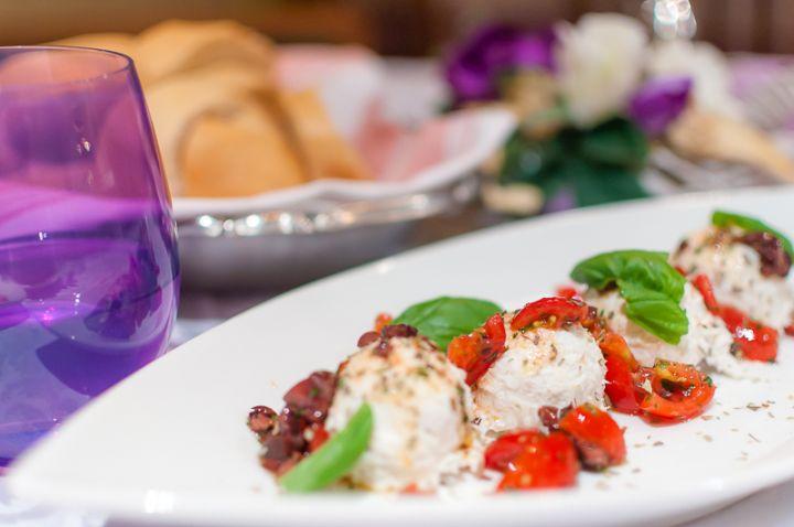 Baccalà mantecato con olio, olive taggiasche, origano e basilico